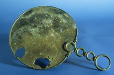 Iron Age, 50 BC - AD 50  From Desborough, Northamptonshire, England    A highlight of British La Tène / Celtic Art    This decorated bronze mirror is one of the finest examples of a type of Iron Age object that was exclusively made in Britain. The decoration is on the back of the mirror, while the other side would have been highly polished.