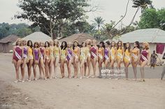 View of female contestants in the 1968 Miss Europe beauty pageant posing wearing swimsuits as they line up in front of residents of Kinshasa in the Democratic Republic of Congo in 1968.