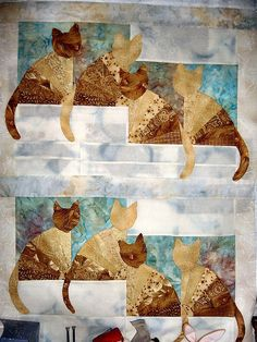 cat quilt with quilted fan pattern for the cats' bodies.