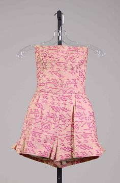 Pink printed cotton strapless bathing suit, by Carolyn Schnurer (textile by Hollander), American, 1951.