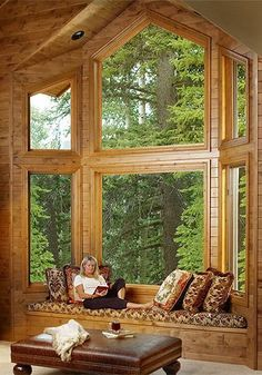 What a backdrop to this window seat. Interior photographer Scott Van Dyke-interior photograph of woman reading a book Log Cabin Homes, Log Cabins, Cozy Nook, Cabins And Cottages, Cabins In The Woods, Architecture, Great Rooms, My Dream Home, Future House