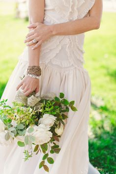 Various greenery more dominant than the flowers // photo by Cameron Ingalls // flowers by Adornments Flowers & Finery // view more: http://ruffledblog.com/equestrian-inspired-wedding-ideas