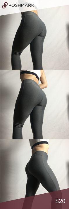Grey gym leggings  w/ scrunch ankle Grey gym leggings - stretchy  - comfortable -scrunch on ankle -M/M -champion  - w/ neon orange/pink inside lining Pants Leggings