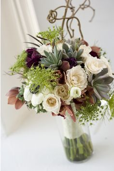 Bouquet of succulents, Moonstruck and Metallina roses, burgundy cymbidium orchids, white anemones, Queen Anne's Lace, and kiwi vine (done for the spring 2012 fashion show at The English Dept.).