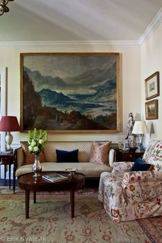 Large oil painting, floral club chair, red lampshade, blue velvet pillows, antiques - Richard Keith Langham