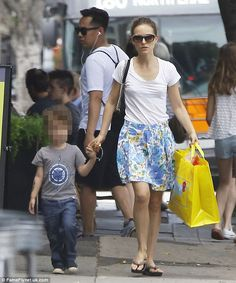 Family time: Natalie Portman looked effortlessly chic as she stepped out into the sunshine...