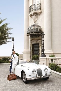 A well-dressed gentleman waiting to whisk his lady away to a romantic weekend via his gorgeous car.  That is what every woman should have. Every woman.