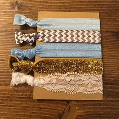 NEW gold and blue hair ties! Just in these adorable no pull hair ties are great for summer! Brand new in package! Will ship out today! Three Bird Nest Accessories Hair Accessories