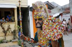 A penitent in a costume made of candy wrappers takes part in a procession for the Moriones Festival during Holy Week in Mogpog town on Marinduque island, central Philippines, on March 27, 2013. During the festival, masked and costumed penitents called Moriones dress in attire that is the local interpretation of what Roman soldiers wore during biblical times. (Reuters/Erik De Castro)