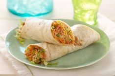 Cheesy Grilled BBQ Chicken Wraps   1 lb. (450 g) boneless skinless chicken breasts 1/2 cup Kraft Original BBQ Sauce, divided 4 large flour tortillas, warmed 3/4 cup Kraft Tex Mex Shredded Cheese 2 cups shredded lettuce