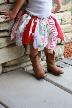 not so much a fan of tutus and ruffles but this is really cute- especially with those boots :) maybe someday there will be a little girl for me to dress up