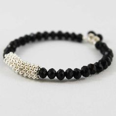This memory wire bangle bracelet is so simple yet so pretty! 6mm shiny black faceted crystal beads are strung with one