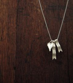 tiny silver chains, single charms & initials are sweet and in fashion. love the hand-stamped banners. $68
