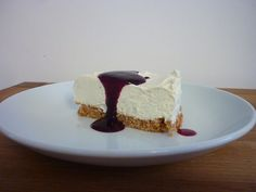 Vanilla Cheesecake with Blueberry Coulis