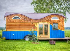 TINY HOUSE TOWN: The Pequod Tiny House From Rocky Mountain Tiny Houses-The colorful Perquod tiny house from Rocky Mountain Tiny Homes. A 208 sq ft tiny house on wheels that comfortably fits a family of four. Tiny House Swoon, Tiny House Living, Tiny House Plans, Tiny House Design, Tiny House On Wheels, House 2, Living Room, Tiny House Mobile, Mobile Home