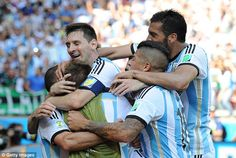 Team game: Messi and his team mates look relieved as they secured qualification from the group late on 1-0