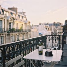 """à votre santé""...A glass of good wine on a balcony in Paris...The night is young..."