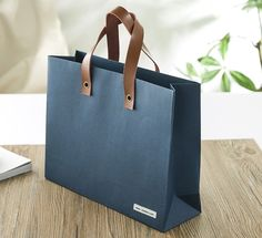 Blue craft shopping bag, leather straps, premium paper bag, special glossy paper bag, luxury paper bag