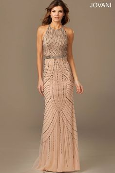 Dazzling nude sleeveless elegant dress features an open back and beaded embellishments