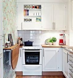 stauraum in der kleinen k che schranksystem handtuchhalter und stangen. Black Bedroom Furniture Sets. Home Design Ideas