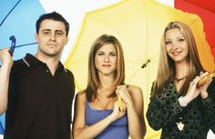 "Primary-colored umbrellas, because why not? | 27 Rare Photos Of The Cast Of ""Friends"" Will Make You Wish It Was 1994 All Over Again"