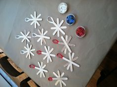 snowflake ornaments--- Ava's bday party craft. (Glue together in advance and have kids paint/decorate with glitter, etc)
