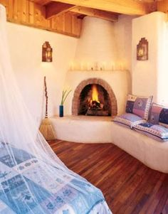 This particular Fireplace remodel is certainly a notable style technique. Adobe Fireplace, Stucco Fireplace, Bedroom Fireplace, Fireplace Remodel, Fireplace Design, Fireplaces, Paint Fireplace, New Mexico Homes, New Homes