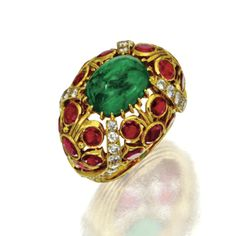 From Sotheby's | Emerald, ruby and diamond ring, Cartier, Paris. Set in the center with an oval cabochon emerald atop an openwork dome set with 24 round rubies and 42 round diamonds, the diamonds weighing a total of approximately 1.25 carats, mounted in 18 karat gold, size 5¼, signed Cartier, Paris, numbered 010073, maker's mark, assay mark. | Cartier Jewelry, Emerald Jewelry, Jewelery, Cartier Rings, Art Deco Jewelry, Vintage Jewelry, International Jewelry, Cocktail Rings, Beautiful Rings