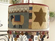 Quilty lamp shade from Quilt House blog.  I'm not sure if this is going too far in my house of sewing/crafting/quilting... but I love it or variations thereof!