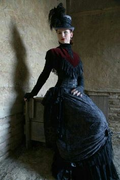 Love the overall gothic influence - lots of black-on-black texture, with the dark red velvet.. yum!