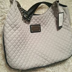 Quilted, must have Nine West, silvery/gray What's not to love, two small inner pockets great for phone and lipsticks, small zipper pocket for the hard to find items that fall to the bottom. This has a black bottom to hide dirt. Chain accent on straps. Perfect condition, just never got around to using it. Nine West Bags Shoulder Bags