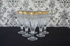 Gold rimmed champagne glasses - Hire from www.thevintageDIYbride.com