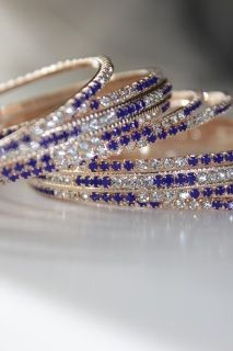 £20 6 Piece Bangle Set Diamante Bangles in deep blue and diamantes. These are available in a number of sizes. Four thin bangles and two wide bangles. Wear on one hand or wear on two hands.Mix with coloured plain bangles or pearl bangles to make this even more of a wow set and to perfectly match your outfit. #Bollywoodstyle #bellydancerjewelry #bangles #bracelets #indianfashion #saree #allthingsblue #royalblue #blue #holiday #lehnga #indianbride