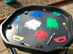 Outdoor learning. Tuff spot. Black tray. Creative development. Art. Painting. Continuous Provision. Teaching. Classroom. Resources. EYFS. Early Years. Reception. Children. Learning.