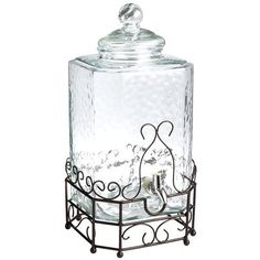 Keep the celebration fluid with our big 2-gallon, serve-yourself Drink Dispenser. Made of shimmering hammered glass on a silver wrought iron stand, it's ready to party at a moment's notice. (Insert hammered joke here.) <br></br> <li>Clear</li> <li>2.15 gal</li> <li>Hammered glass</li> <li>Hand wash only</li> <li>Not microwaveable</li> <li>Not safe for hot liquids</li>