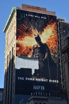 WHOA. Check out this huge PAINTING of The Dark Knight Rises. They don't make posters that big, so 4 guys worked 5 days to make the thing, like a giant paint-by-numbers.