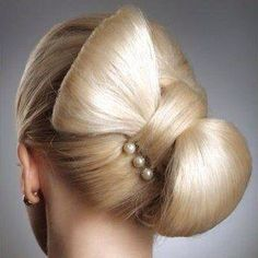 Hairstyle in the style of a bowtie...updo for a special event...