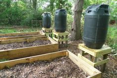 Make your own rain barrels & set them up to water your garden!
