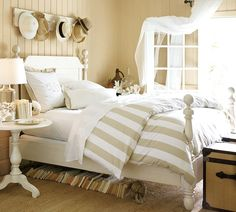 Pottery Barn bed. I like the wall pegs with hats!