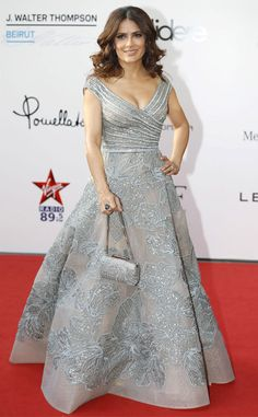 Salma Hayek from The Best of the Red Carpet  Now this is how it's done! Salma schools the crowd at The Prophet premiere in Beirut wearing an enviable embellished Elie Saab Haute Couture gown.