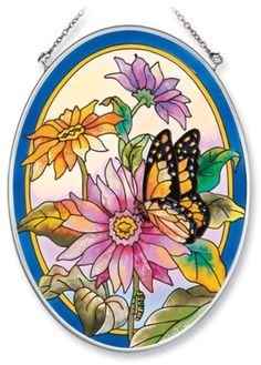 Amia Hand Painted Glass Suncatcher with Daisy and Butterfly Design, 5-1/4-Inch by 7-Inch Oval by Amia. $19.00. Comes boxed, makes for a great gift. Includes chain. Handpainted glass. Amia glass is a top selling line of handpainted glass decor. Known for tying in rich colors and excellent designs, Amia has a full line of handpainted glass pieces to satisfy your decor needs. Items in the line range from suncatchers, window decor panels, vases, votives and much more.
