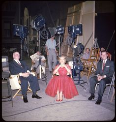 "Alfred Hitchcock and Grace Kelly behind the scenes during the filming of ""Dial M For Murder"""