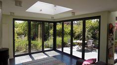 Corner bifold door installation in Muswell Hill, north London Sliding Door Window Treatments, House Design Kitchen, Door Installation, Outdoor Doors, Corner Door, Garage Door Design, Corner Bifold Doors, Corner House, Window Styles
