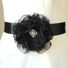 Our Dita Black Chiffon and Lace Fabric Flower Bridal Sash features a captivating 4 1/2 fabric flower with interchanging layers of delicate