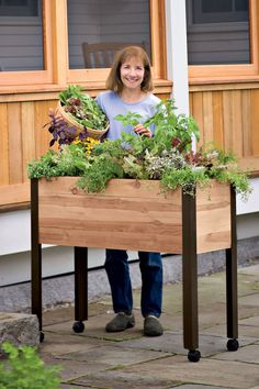 "Elevated Garden Beds on Legs | Standing Garden | Made in Vermont Cedar with powder-coated aluminum legs 39-1/2"" L x 16-1/2"" W x 32"" H overall 10-1/2"" deep planting area Holds 100 quarts of container mix 4-gallon water reservoir"