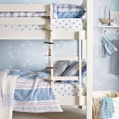 Nautical child's room with bunk bed and maritime wallpaper