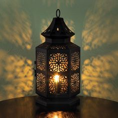 This gorgeous cutout metal table lamp create intricate and varied patterns when the single bulb lights up.