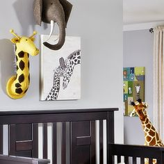 Can't get enough of this darling giraffe cuddling art from @judithrayeart! Perfect in a safari-themed nursery.