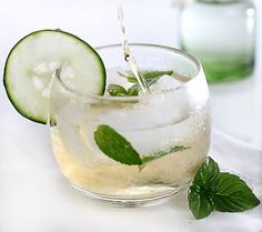 Elderflower Champagne Cocktail Recipe | SAVEUR; prosecco and st germain garnished with mint and cucumber slice