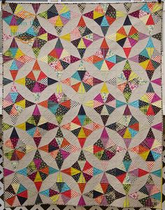 """from the blue chair: Block: 8"""" Kaleidoscope cut using the Kaleidoscope Triangle Ruler by Marti Michell"""